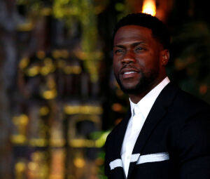 Cast member Kevin Hart poses at the premiere for