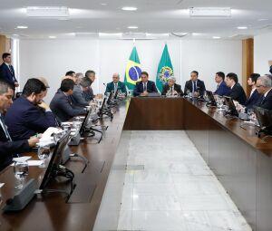 O presidente Jair Bolsonaro em reunião no Planalto com secretários estaduais de Segurança