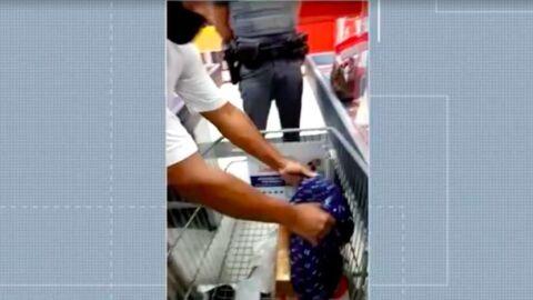 Vídeo: no supermercado, casal negro é obrigado a esvaziar bolsa para revista; PM só acha uma bíblia
