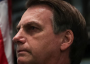 """Bolsonaro: """"Brasil e Estados Unidos acima de tudo"""", em seguida bateu continência à bandeira american"""