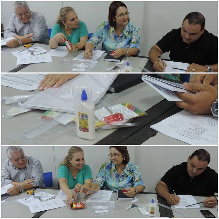 Equipe da Semed fazendo a análise dos kits de material<br />Foto: Tayná Biazus
