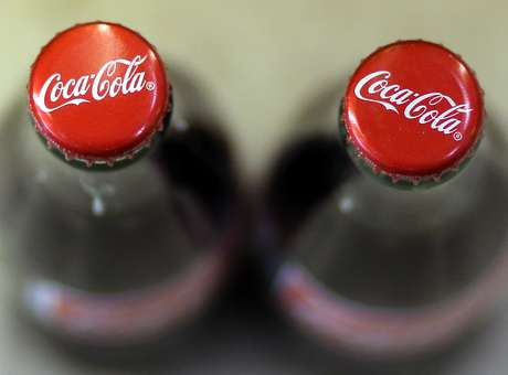 O corte de empregos faz parte dos planos de redução de custos de US$ 3 bilhões da Coca-Cola<br />Foto: Getty Images