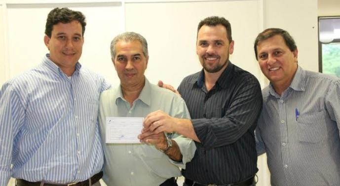 Sérgio de Paula, com Reinaldo e Juvenal na filiação do ex-adversário José Paulo Paleari - Foto Chico Ribeiro